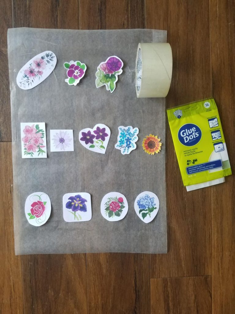 DIY stickers laying on strips of tape