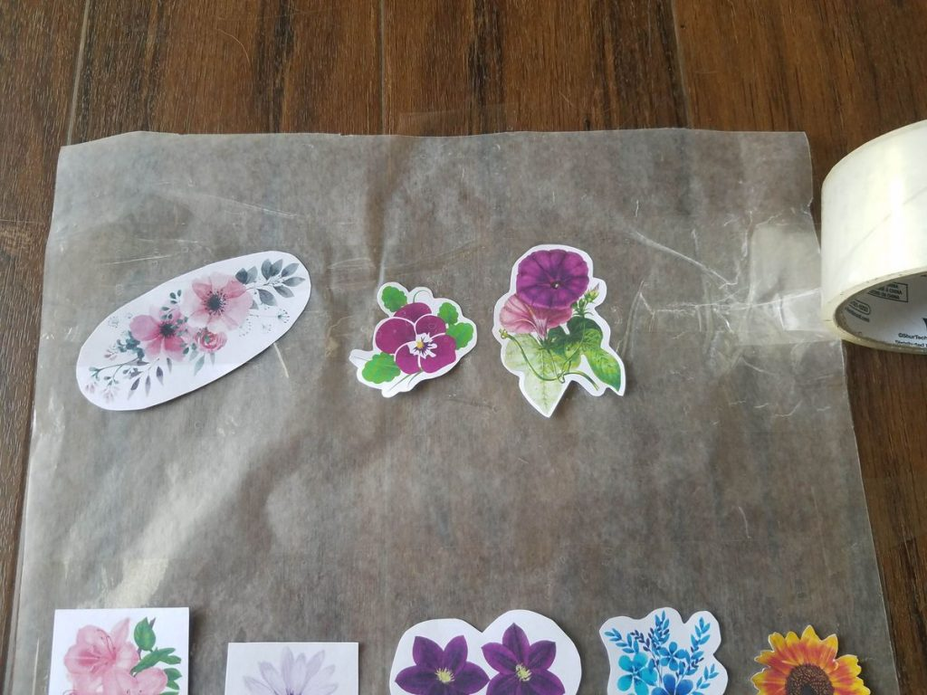 Adding a top layer of tape over stickers