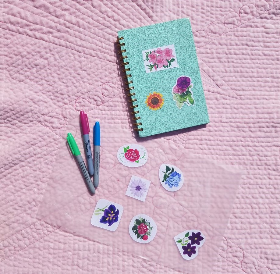 Homemade stickers on a notebook